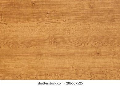Background of a wooden table surface with fine texture.