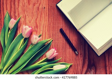 background wooden with tulip and tea