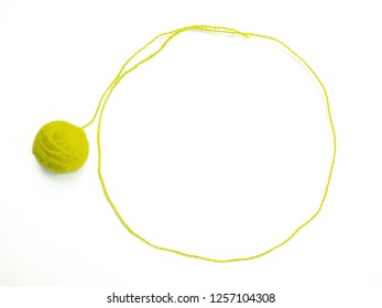 Background of wool yarn, knitted yarn, can also be used as a yarn frame. Yellow knitting yarn for handicrafts isolated on white background.
