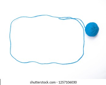 Background of wool yarn, knitted yarn, can also be used as a yarn frame. Blue knitting yarn for handicrafts isolated on white background.