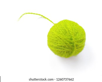 Background of wool yarn, knitted yarn, can also be used as a yarn frame. Green knitting yarn for handicrafts isolated on white background.