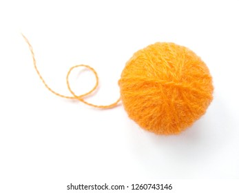 Background of wool yarn, knitted yarn, can also be used as a yarn frame. Orange knitting yarn for handicrafts isolated on white background.