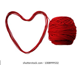 Background of wool yarn, knitted yarn, can also be used as a yarn frame. Red knitting yarn for handicrafts isolated on white background.