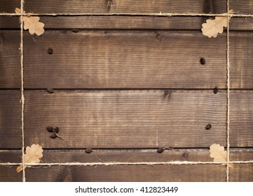 "background for writing ""plank of dark wood with oak leaves"""