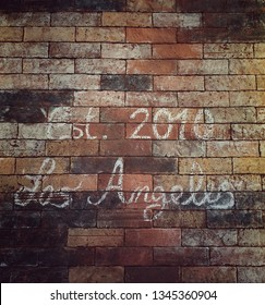 The background of the written text 'Est. 2010 Los Angeles' on the wall brick in vintage style