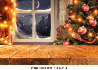 background of xmas time and xmas tree with window of winter