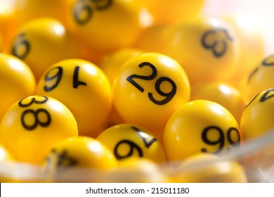 Background of yellow balls with bingo numbers used to randomly select lucky numbers during a bingo game