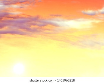 background of yellow and orange sky with clouds and sun