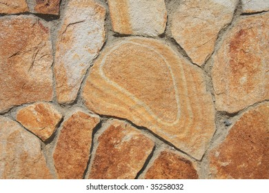 Background of yellow striped sandstone and cement.