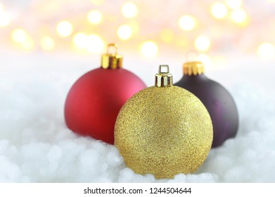Background for your Christmas promotion filled with colorful baubles and bright lights