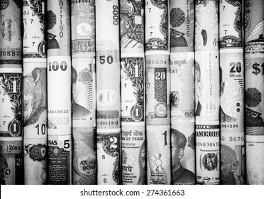 A backgrounds with black and white color of many roll currency from many country