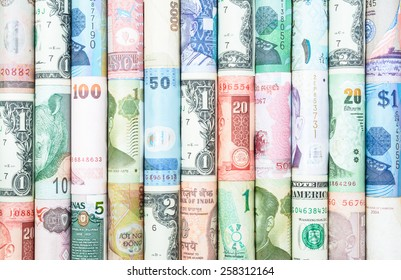 A backgrounds with colorful of many roll currency from many country