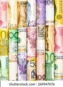 A backgrounds with colorful of many roll currency,money from many country