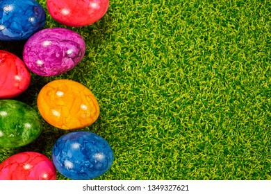 Backgrounds for the easter with eggs and flowers on grass and plaz for a caption - Shutterstock ID 1349327621