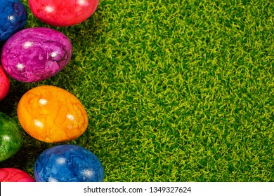 Backgrounds for the easter with eggs and flowers on grass and plaz for a caption - Shutterstock ID 1349327624
