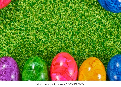 Backgrounds for the easter with eggs and flowers on grass and plaz for a caption - Shutterstock ID 1349327627
