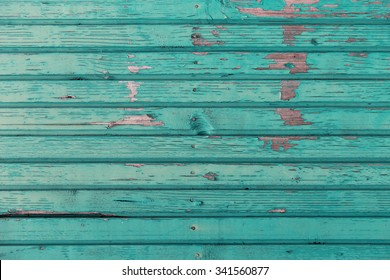 backgrounds and texture concept - old wooden fence painted in blue background