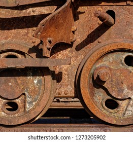 Backgrounds and textures: abandoned railway car wheels, broken and rusty