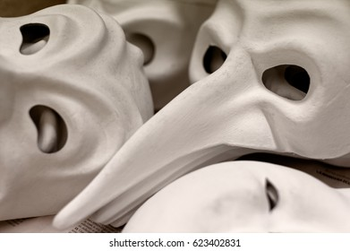 Backgrounds and textures: big group of unfinished traditional Venice masks, plain white paper