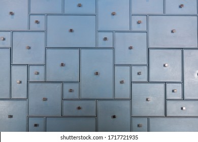 Backgrounds and textures: front of old wooden closet door with drawers as background. Abstract Old rusty vintage drawer door background.