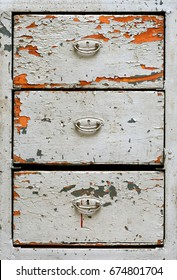 Backgrounds and textures: front surface of very old painted wooden drawers cabinet, abstract close-up shot