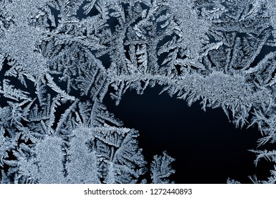 Backgrounds and textures: frost pattern on a window glass