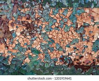 Backgrounds and textures: layers of old cracked paint on rusty metal surface