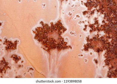 Backgrounds and textures: macro shot of rust on old paint, artistic pattern, industrial or organic abstract