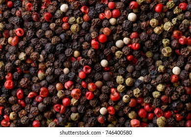 Backgrounds and textures: a lot of multicolored pepper corns, close-up shot, culinary abstract