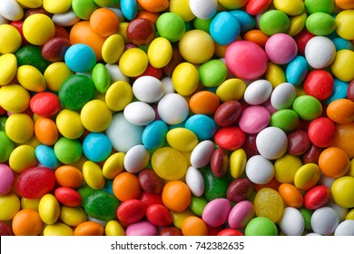 Backgrounds and textures: a lot of multicolored round candies, 	confectionery abstract