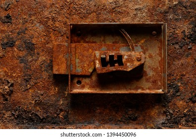 Backgrounds and textures: old broken corroded safe lock on rough rusty background