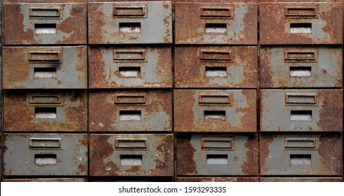 Backgrounds and textures: old rusty metal closet with pullout drawers, close-up shot