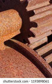 Backgrounds and textures: pair of rusty steel cogwheels, closeup shot, industrial abstract