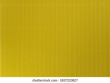 Backgrounds and textures: paper corrugated background. Yellow, vertical stripe. Kyiv (Kiev), Ukraine, Europe.