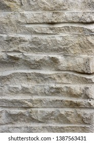 Backgrounds and textures: rough weathered stone texture, exterior wall or floor of rustic building