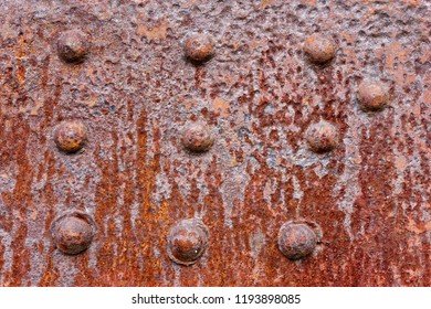 Backgrounds and textures: rusty metal wall surface with riveted joints, industrial abstract