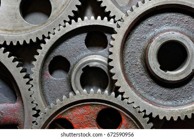 Backgrounds and textures: set of connected steel cogwheels, big, heavy and old, industrial abstract