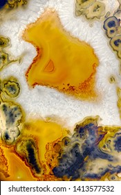Backgrounds and textures: surface of agate or chalcedony, beautiful decorative stone, abstract pattern of cracks, spots and stains, natural background