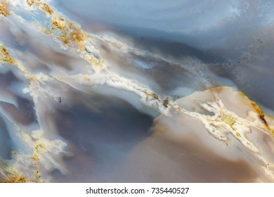Backgrounds and textures: surface of beautiful decorative stone, abstract pattern of cracks, spots and stains, natural background
