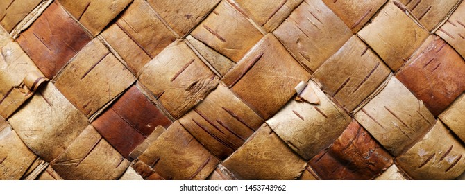 Backgrounds and textures: traditional handmade container detail, wattled pattern made of birch bark