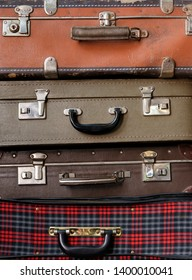 Backgrounds and textures: various stacked old luggage bags
