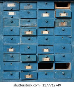 Backgrounds and textures: very old broken blue wooden cabinet with drawers