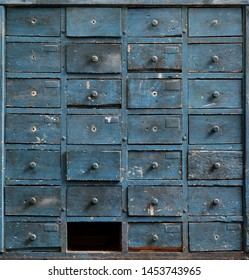 Backgrounds and textures: very old dark blue wooden cabinet with drawers