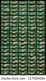 Backgrounds and textures: very old green metal cabinet with wooden drawers