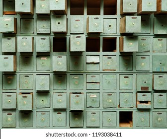Backgrounds and textures: very old green wooden cabinet with drawers