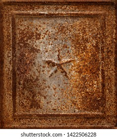 Backgrounds and textures: very old rusty cast-iron panel with star shape relief