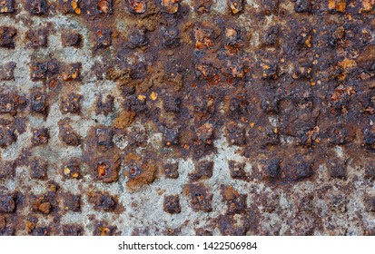 Backgrounds and textures: very old rusty cast-iron relief flat floor panel