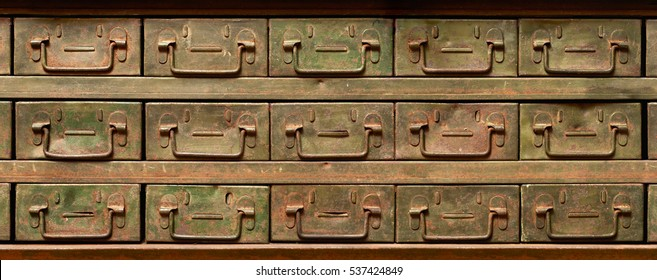 Backgrounds and textures: very old, rusty and worn, metal cabinet with drawers