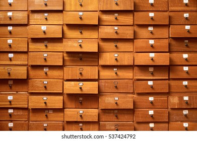 Backgrounds and textures: very old wooden cabinet with drawers