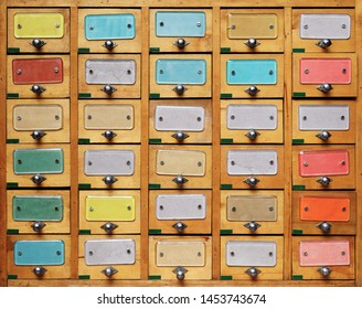 Backgrounds and textures: vintage wooden cabinet with drawers with multicolor labels